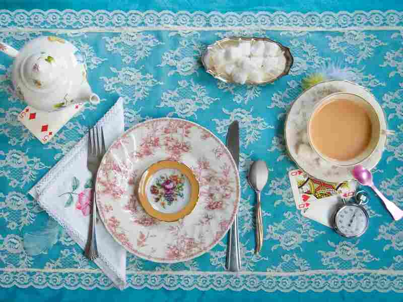 """"""" 'Have some wine,' the March Hare said in an encouraging tone. Alice looked all round the table, but there was nothing on it but tea."""" (Alice in Wonderland by Lewis Carroll)"""