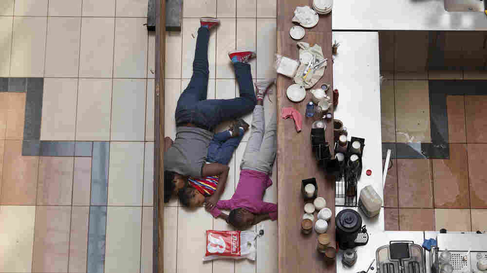Tyler Hicks took this photo of a woman sheltering her children on the floor of a cafe at the Westgate Mall during an attack by militants in Nairobi on Sept. 21, 2013. The woman later contacted Hicks and told him she kept her kids quiet and still b