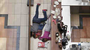 Tyler Hicks took this photo of a woman sheltering her children on the floor of a cafe at the Westgate Mall during an attack by militants in Nairobi on Sept. 21, 2013. The woman later contacted Hicks and told him she kept her kids quiet and still by singing along to songs that were playing on the mall loudspeakers.