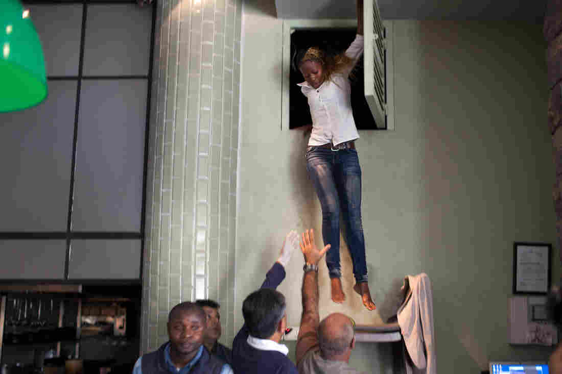 A woman leaps from a vent at a sushi restaurant in the Westgate Mall where she took refuge during the attacks.