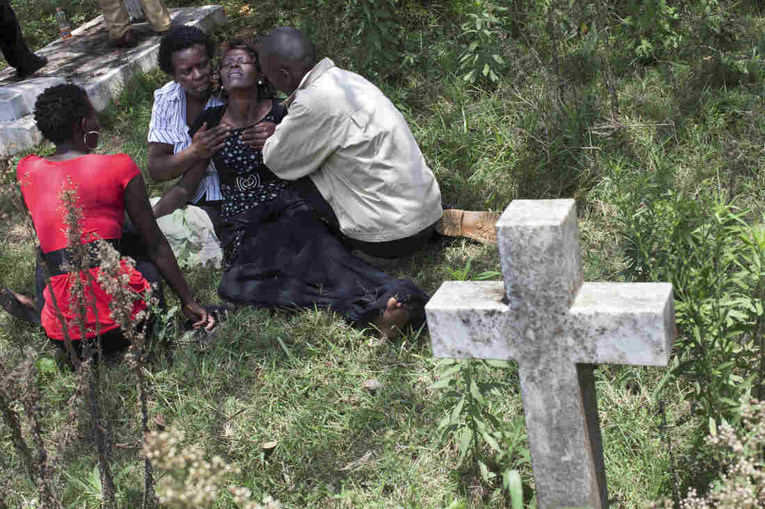 Family, friends and colleagues attend the funeral of Ruth Njeri Macharia at Langata Cemetery in Nairobi. Macharia, who worked at the Westgate Mall's Art Cafe, was killed in the attack.