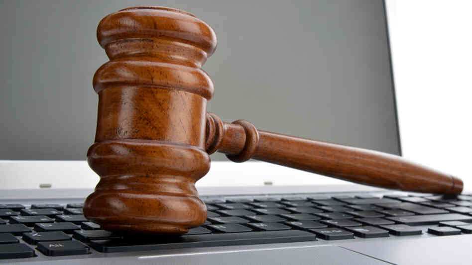 Gavel on laptop.
