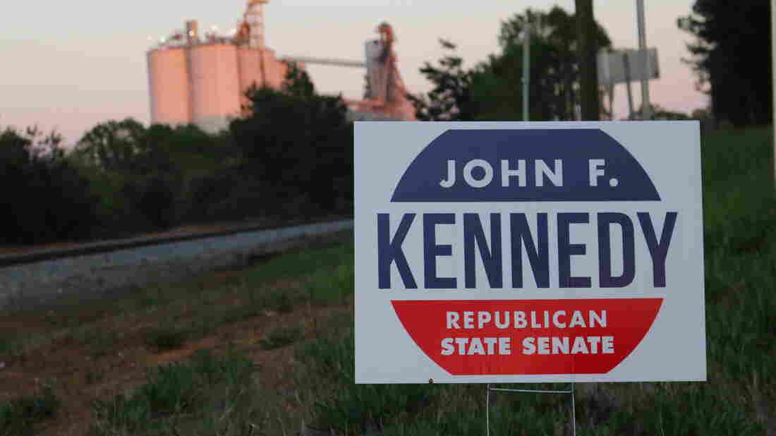 A campaign sign for John F. Kennedy, a Republican running for office in Georgia, by the railroad tracks outside the city of Forsyth.
