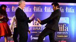 Bollywood star Anil Kapoor (right) engages the mayor of Tampa Bob Buckhorn in a dance during a press conference for the 15th International Indian Film Academy (IIFA) Awards in Tampa, Fla., on Thursday.