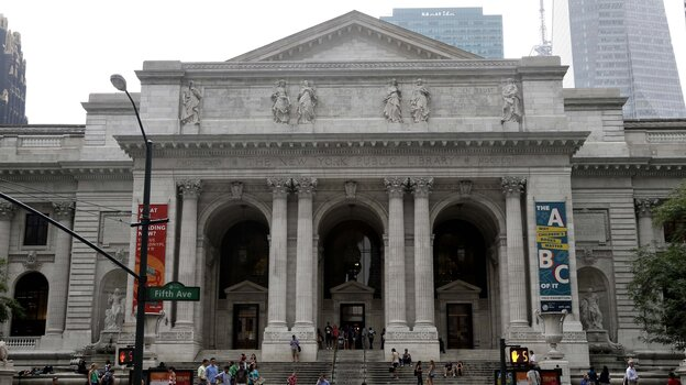 Pedestrians walk past the main branch of the New York Public Library