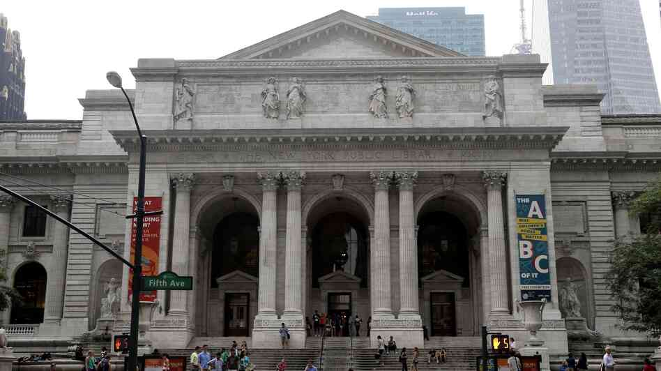Pedestrians walk past the main branch of the New York Public Library in New York City in this 2013 photo.