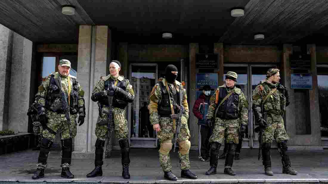 Armed pro-Russia activists stand outside the Ukrainian regional administration building in the eastern Ukrainian town of Slovyansk on April 14.