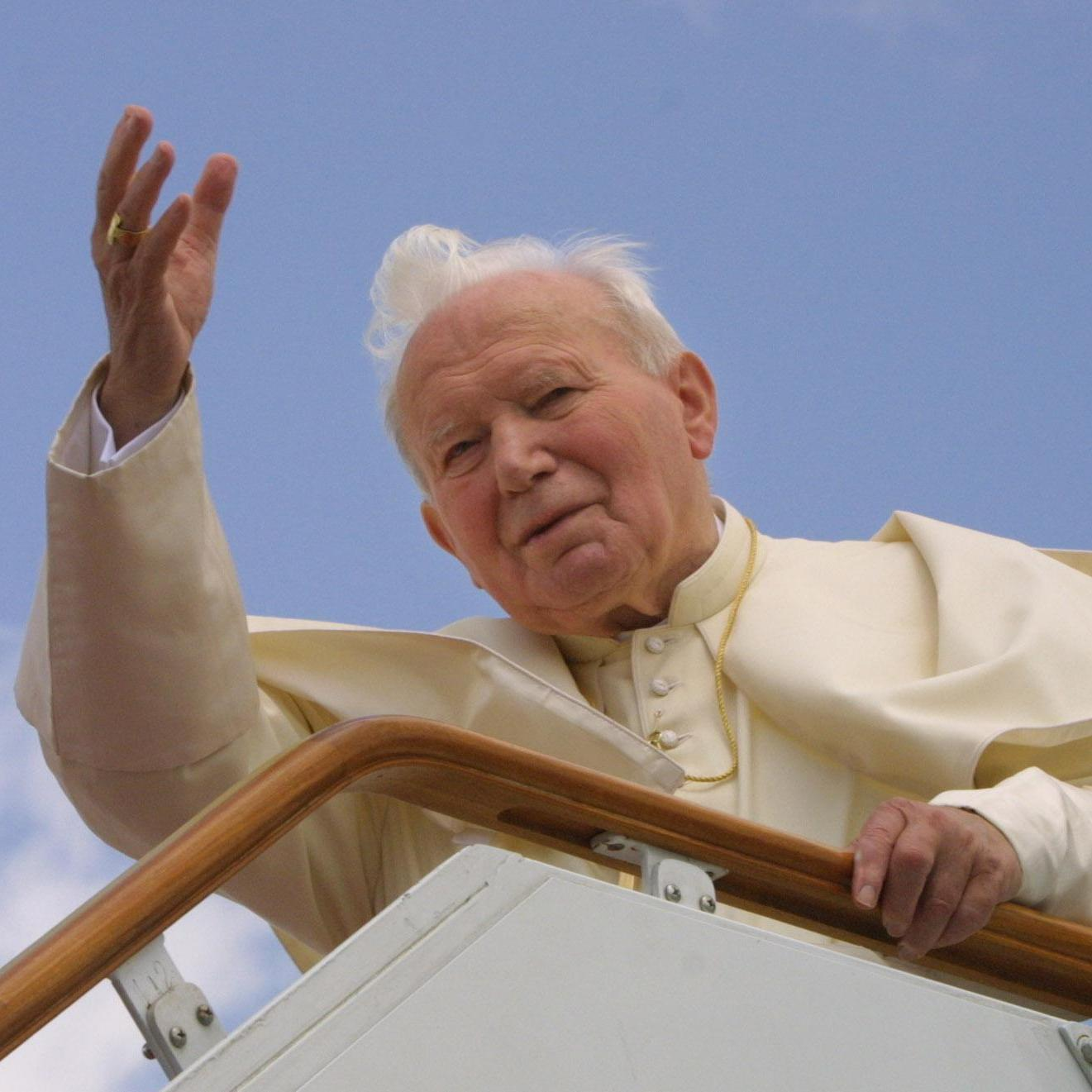 Pope John Paul II waves from the gangway of his plane in 2001 as he leaves Damascus for Malta on the last leg of his three-nation pilgrimage in the footsteps of St. Paul.