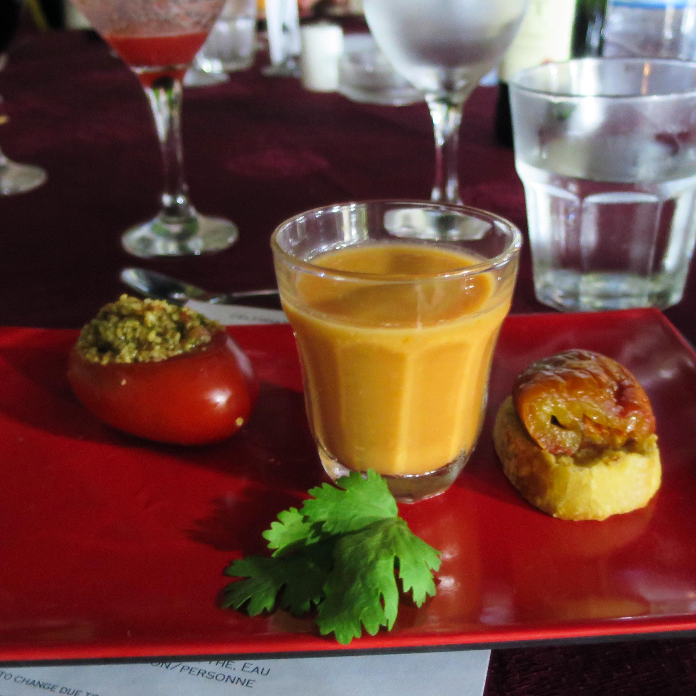 A couscous-stuffed tomato, tomato gazpacho and a piece of bruschetta at a recent Trio Toques event.
