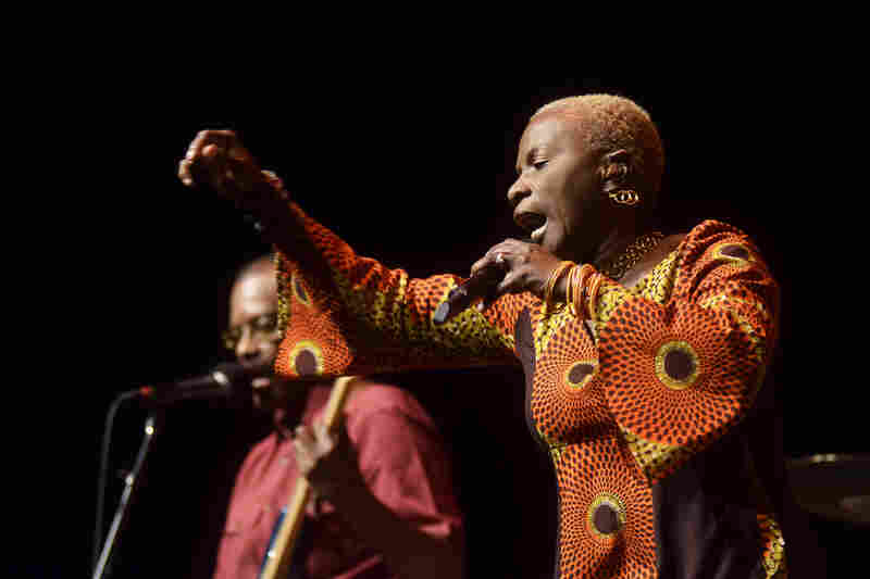 "Kidjo describes her latest album, Eve, as ""a remembrance of the African women I grew up with, and a testament to the pride and strength that hide behind the smile that masks everyday troubles."""