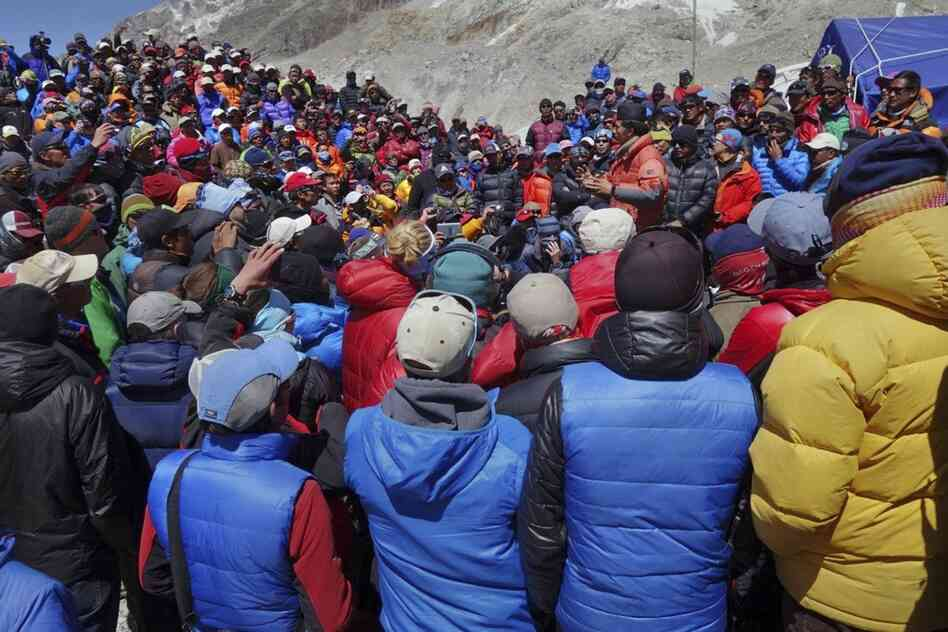 A Nepalese government delegation met with Sherpa mountain guides near Mount Everest's base ca