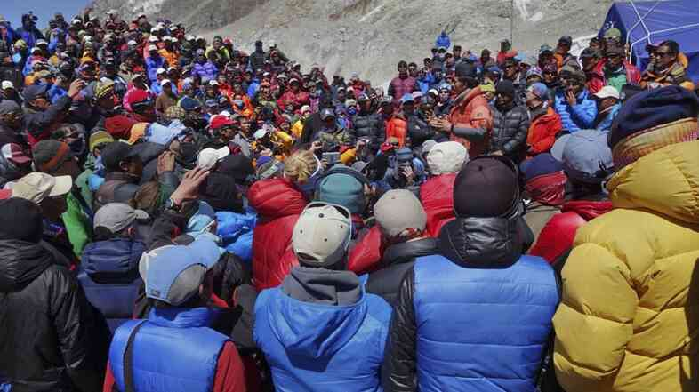 A Nepalese government delegation met with Sherpa mountain guides near Mount Everest's base camp on the south side of the mountain Thursday