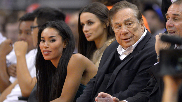 An October 2013 photo shows Los Angeles Clippers owner Donald Sterling, right, and V. Stiviano, left. A recording released Friday includes racist comments allegedly made by Sterling as the couple argued. The NBA is investigating the claim. (AP)