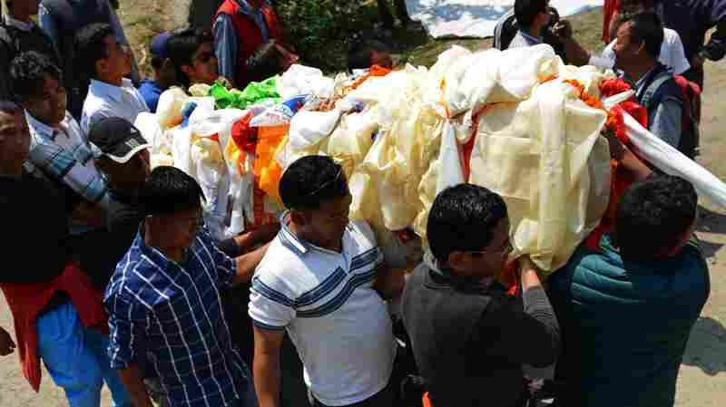Relatives carry a casket bearing the body of a Mount Everest avalanche victim for cremation in Kathmandu on Monday.