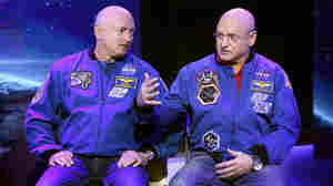 Mark Kelly (left) will stay on Earth while his brother, Scott Kelly, spends a year on the International Space Station. NASA will tes