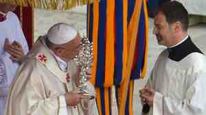 Pope Francis kisses the relic of Pope John XXIII during the canonization mass.