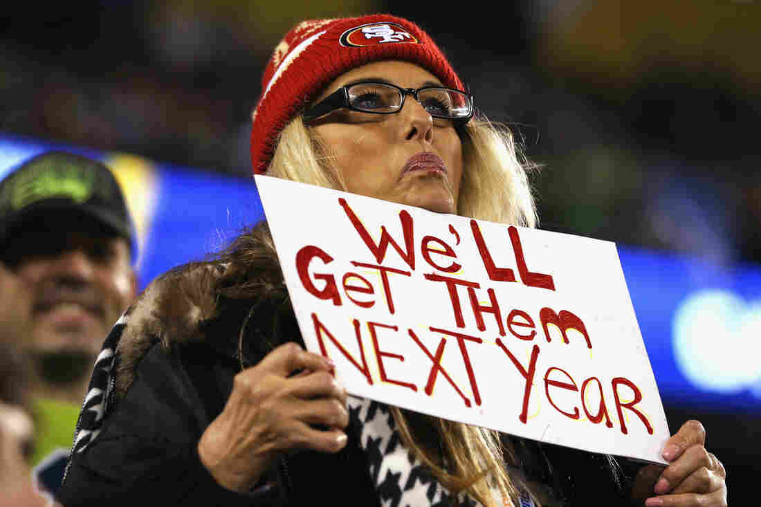A 49ers fan displays her hopes for next season at a Seahawks game. If a San Francisco fan has his way, the sign could also refer to playoff tickets, which were limited to markets with strong Seattle support this year.