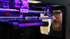 Andy Leer of maker space chain TechShop calibrates a 3-D printer at a GE-sponsored pop-up workshop in Washington, D.C. Maker spaces, which offer access to industrial-grade tools, are attracting support from governments and big companies like Ford