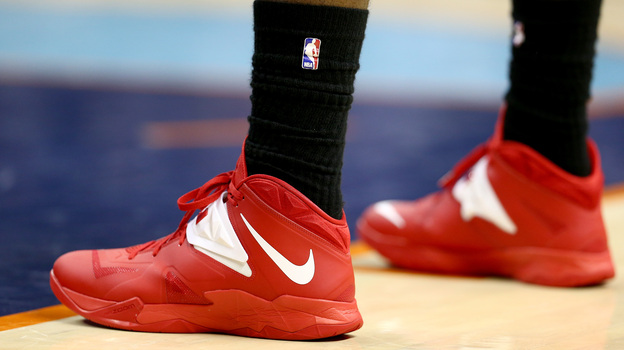 LeBron James of the Miami Heat wears black socks to protest Clippers owner Donald Sterling during the Heat's playoff game Monday against the Charlotte Bobcats. Stars throughout the NBA have offered bitter rebukes of Sterling. (Getty Images)
