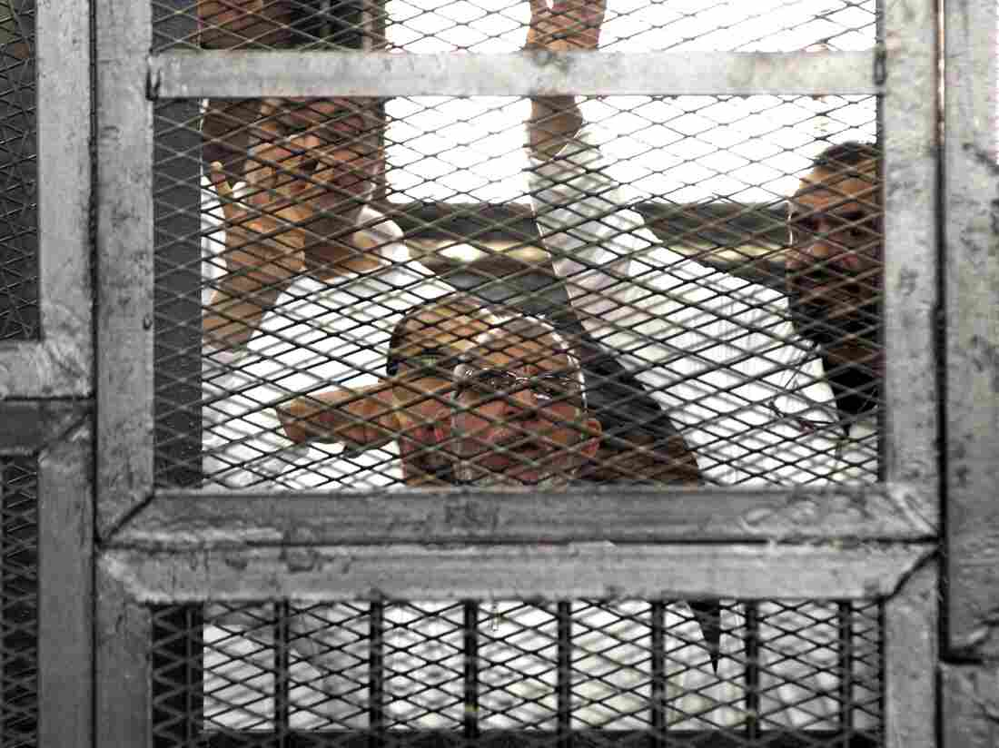 Muslim Brotherhood leader Mohammed Badie (center) and senior Brotherhood figure Salah Soltan (right) appear in court in Cairo earlier this month.