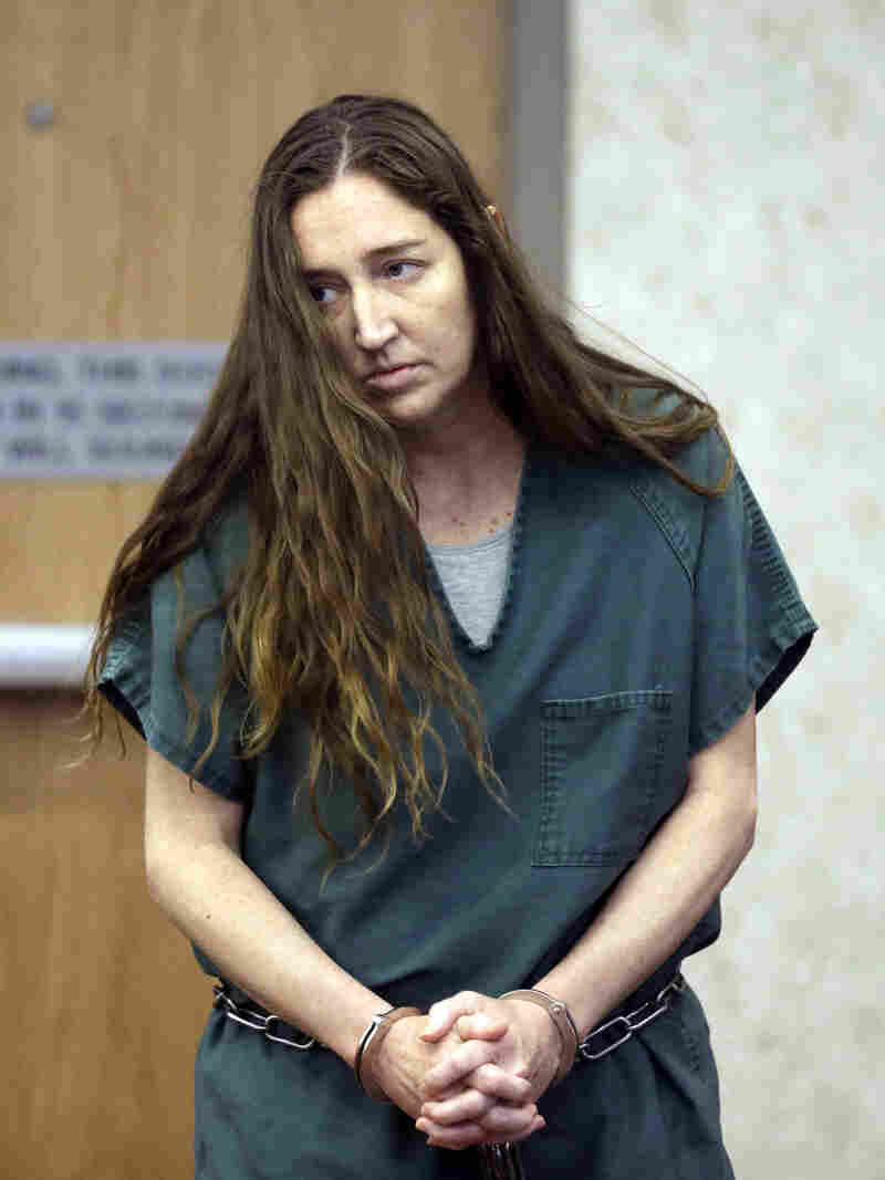 Megan Huntsman, accused of killing six of her babies and storing their bodies in her garage, appears in court on Monday in Provo, Utah. Prosecutors have filed six first-degree murder charges against her.