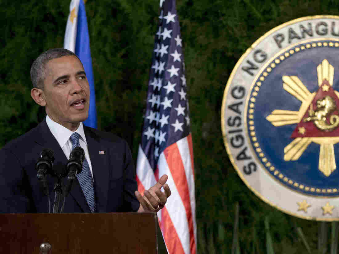 President Obama speaks during a joint news conference with Philippine President Benigno Aquino III at Malacanang Palace in Manila, Philippines, on Monday. Obama said the U.S. and EU were planning new economic sanctions against Russia.
