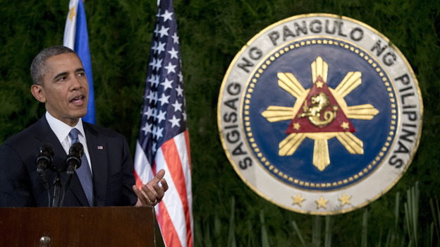 President Obama speaks during a joint news conference with Philippine President Benigno Aquino III at Malacanang Palace in Manila, Philippines, on Monday. Obama said the U.S. and EU were planning new economic sanctions against Russia. (AP)