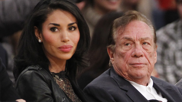 Los Angeles Clippers owner Donald Sterling and V. Stiviano watch the Clippers play the Los Angeles Lakers during a 2010 NBA preseason game. (AP)
