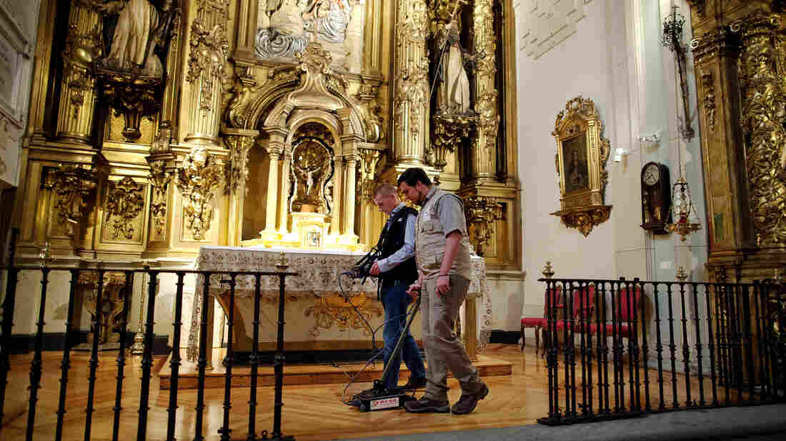 Researchers search for the remains of writer Miguel de Cervantes at Convento de las Trinitarias Descalzas, or Convent of the Barefoot Trinitarians, on Monday in Madrid. Cervantes died in 1616, and his dying wish was to be buried here — the nuns of the convent helped negotiate his freedom after pirates captured and imprisoned him for five years.