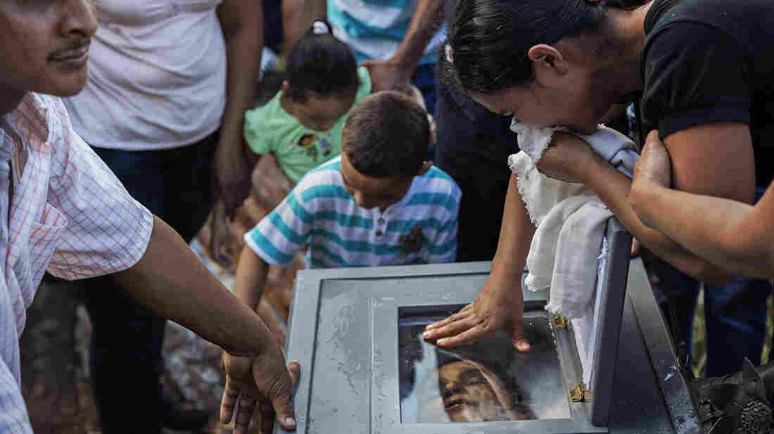 Loved ones express their grief at the burial of Ramon Romero Ramirez in Chichigalpa, Nicaragua, January 2013. The 36-year-old died of chronic kidney disease after working in the sugar cane fields for 12 years. Ram