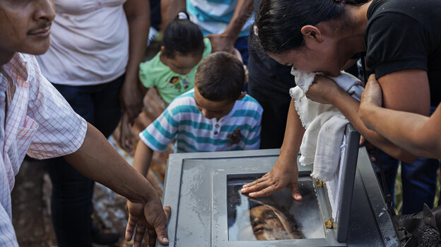Loved ones express their grief at the burial of Ramon Romero R