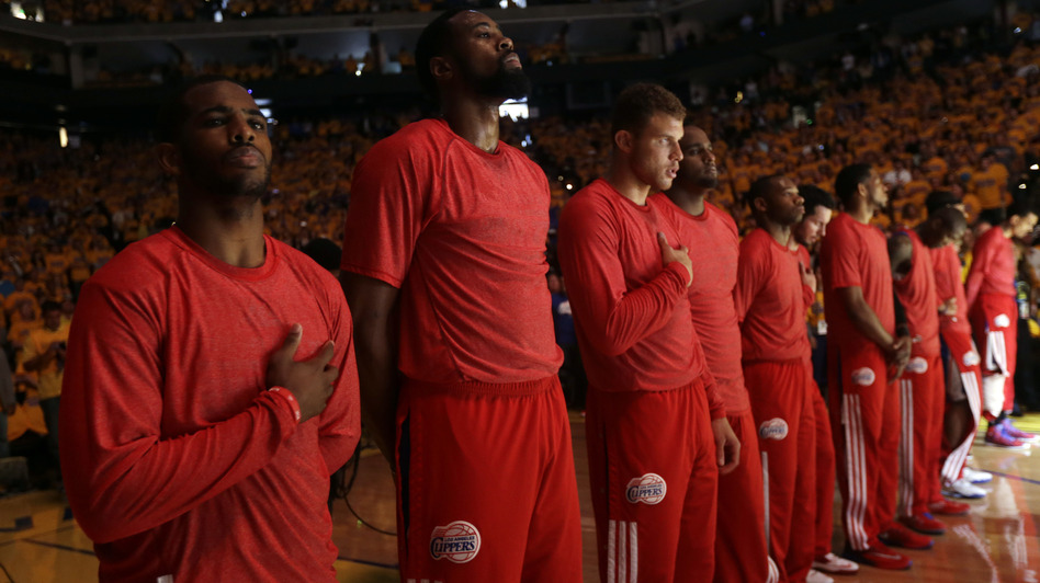 In a protest against comments attributed to Los Angeles Clippers owner Donald Sterling, the team's players wore their red warm-up shirts inside out to hide the team's logo. The NBA is still working to confirm Sterling made the controversial statements. (AP)