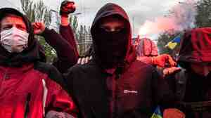 Armed pro-Russian militants attacked a demonstration of supporters of Ukraine in Donetsk on Monday.