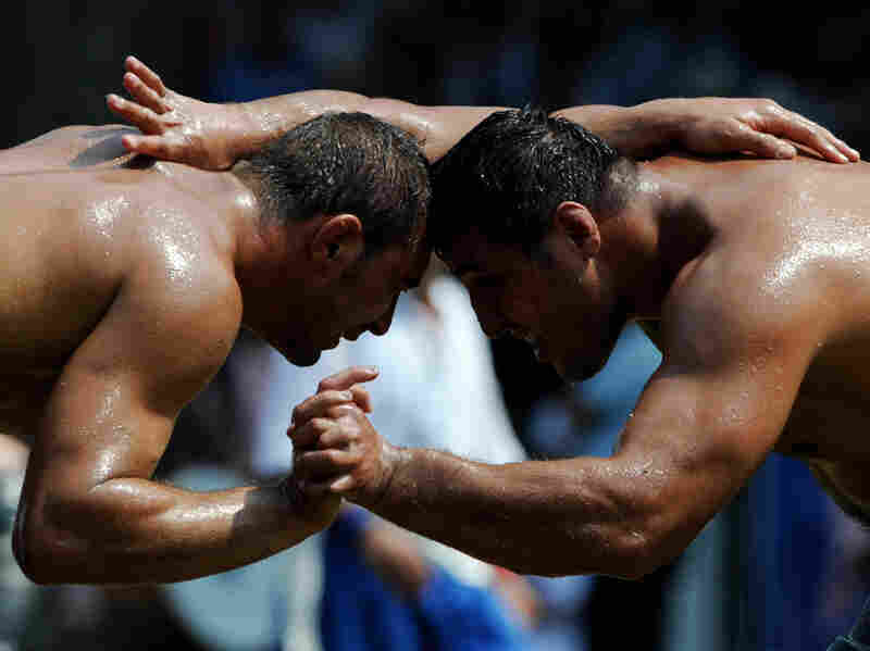 Turkish oil wrestlers compete during the 648th historical Kirkpinar oil-wrestling tournament in Sarayici, near Edirne, in 2009.