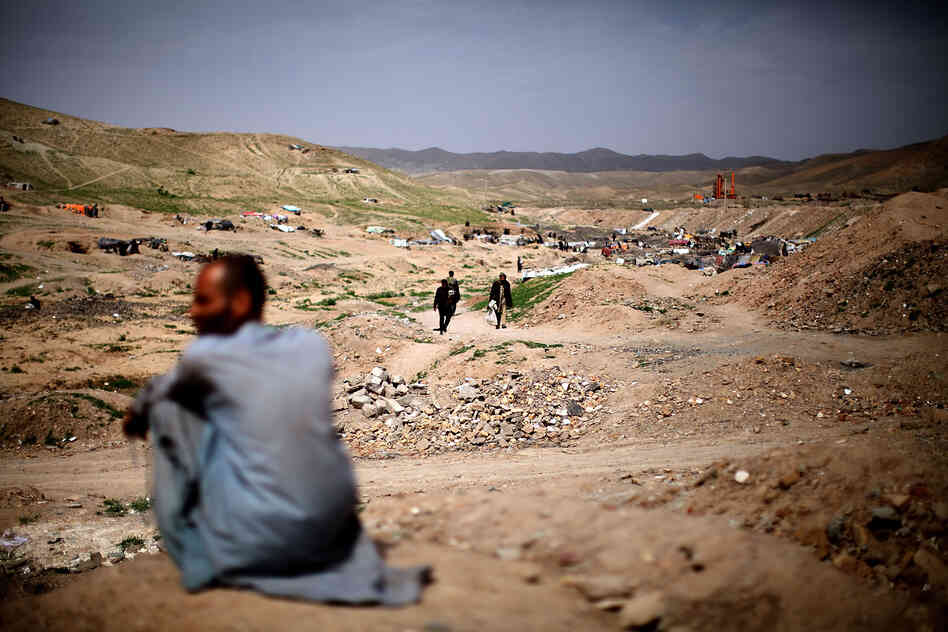 A man sits near the entrance to Kamar Kulagh, just outside Herat and near the border with Iran. The wars and upheavals in Afghanistan over the past three decades have contributed to the widespread use of drugs.