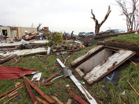 Tornadoes killed at least 17 people on Sunday and Monday. But some managed to stay safe in underground shelters like the one at right in Vilonia, Ark.