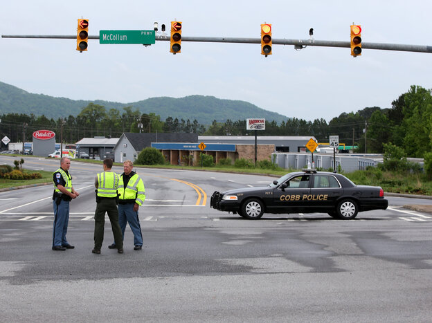 Cobb County Police block off Old US 41 Highway after an early morning workplace shooting at the Airport Road FedEx facility o