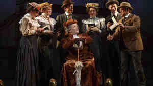 Jefferson Mays, seated center, with the cast during a performance of A Gentleman's Guide to Love and Murder. Tuesday
