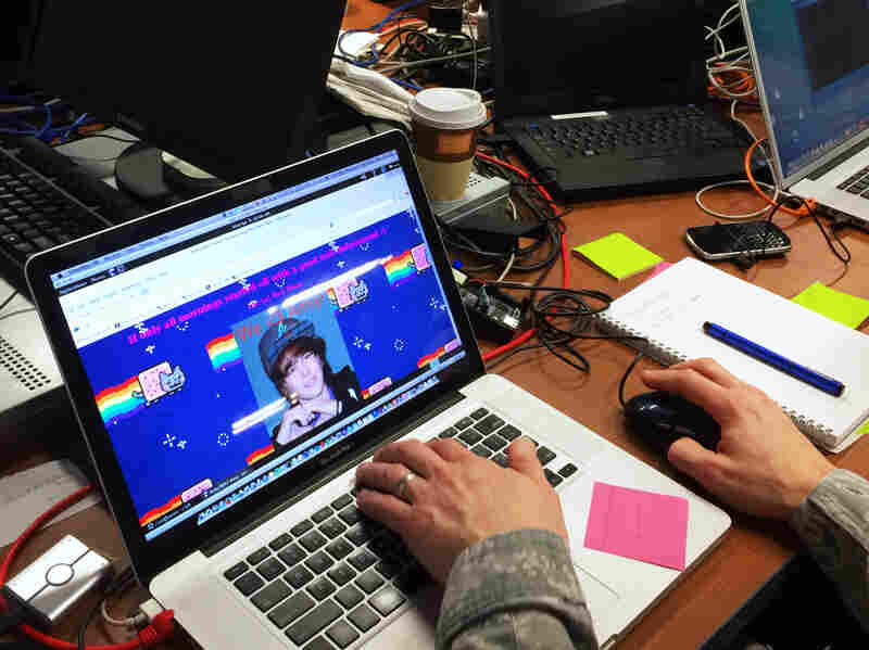 Col. Sam Kinch, of the Delaware Air National Guard, is leader of the Linux team of the NSA's red cell. He's looking at a Web page featuring a photo of Justin Bieber — confirmation that his team has successfully hacked into a U.S. Naval Academy network.