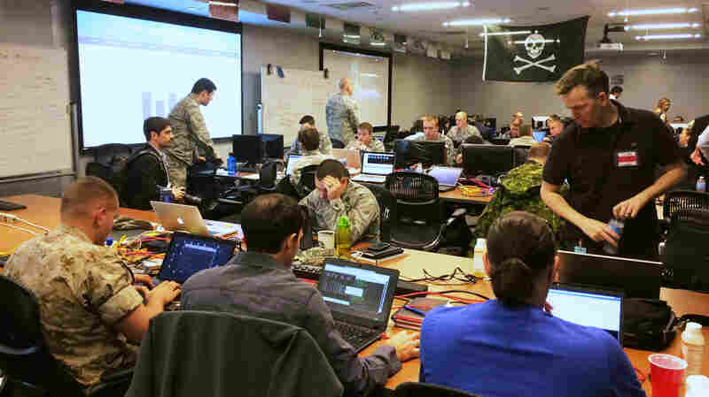 Computer hacking experts from the National Security Agency and various branches of the U.S. armed services try to break into remote networks set up by competing U.S. military service academies. The hackers'€™ war room is in a building in Columbia, Md., owned by Parsons, a U.S. defense contractor.