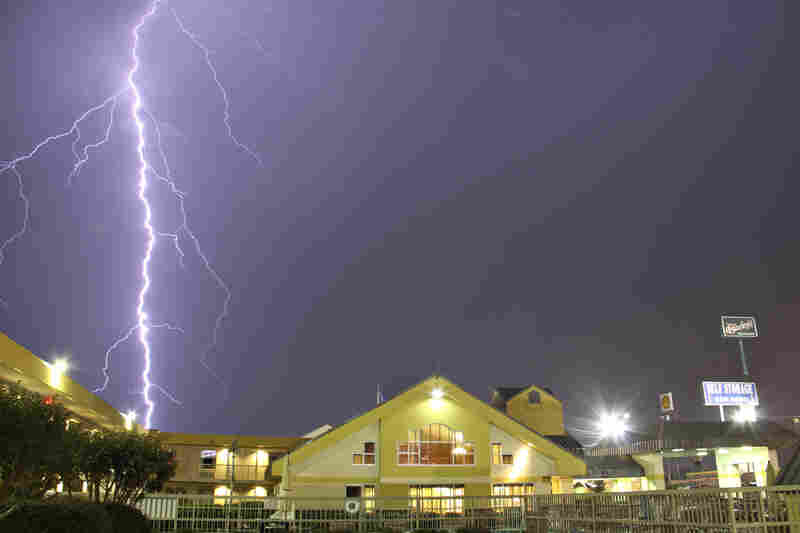 """Lightning strikes from a tornado in Tuscaloosa, Ala., on Monday. """"Tens of thousands of customers were without power in Alabama, Mississippi and Kentucky, which did not report tornadoes but was slammed with severe storms,"""" The Associated Press said."""