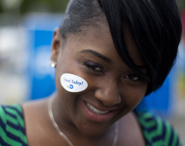 """A young Miami voter wears her """"I voted today"""" sticker in October 2012."""