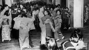 U.S. servicemen and their Japanese partners dance to jazz tunes in the newly opened Tokyo nightclub Oasis of the Ginza, circa 1945.