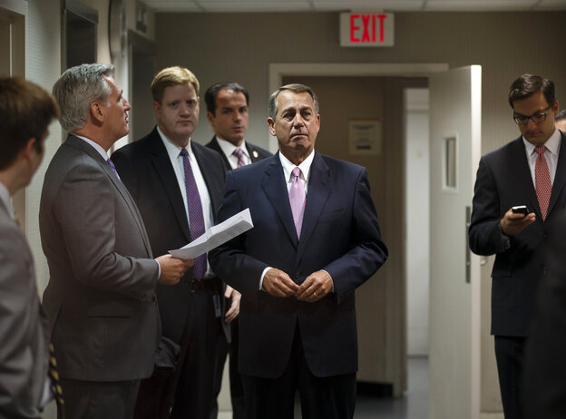 House Speaker John Boehner, R-Ohio, listens to House Majority Whip Kevin McCarthy, R-Calif., before talking to reporters at the Republican National Committee headquarters on April 29.
