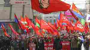 Communist Party supporters carry red flags during their rally to mark International Labor Day in downtown Kharkiv, Ukraine, on Thursday. In recent weeks, pro-Russia separatists have seized key installations in several cities in eastern Ukraine.