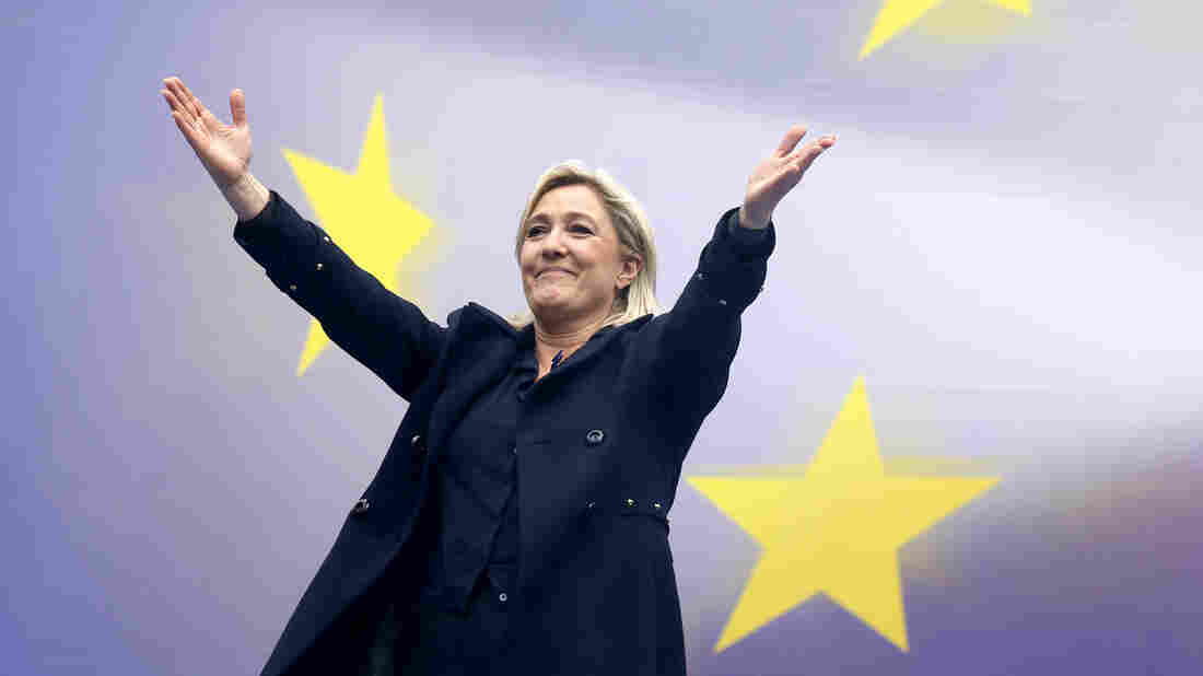 Marine Le Pen, France's National Front political party leader, reacts as she attends their traditional rally in Paris on Thursday.