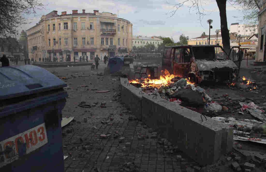 Trashed items smolder amid debris at a square following clashes in Odessa, Ukraine, on Friday.