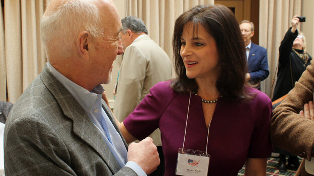 Oregon Republican Senate candidate Monica Wehby, right, talks to supporter Marvin Hausman in Lake Oswego, Ore. Wehby has drawn national attention and money in her effort to win her party's nomination.