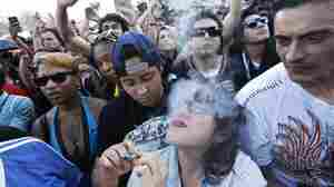 Partygoers listen to live music and smoke pot on the second of two days at the annual 4/20 marijuana festival in Denver, last month. While the sale of marijuana is legal in the state, a legal finance mechanism is still in doubt.