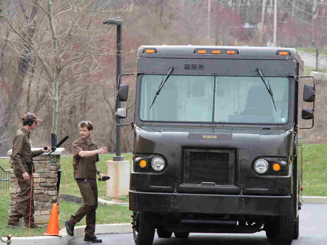 Planet Money's Jacob Goldstein (left) rode along with UPS driver Bill Earle. Company rules require anyone who rides on a UPS truck to wear a uniform.
